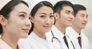 Healthcare workers standing in a row, China
